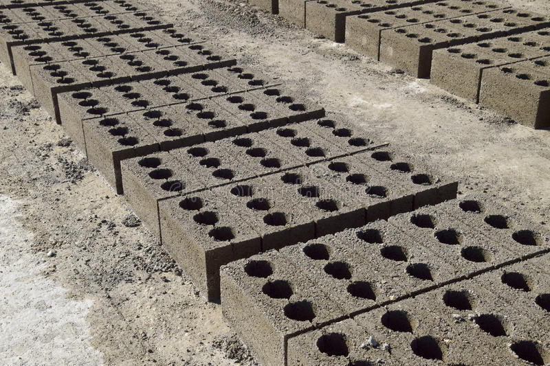 Cinder blocks lie on the ground and dried. on cinder block production plant. Cinder blocks lie on the ground and dried. on cinder block production plant stock images