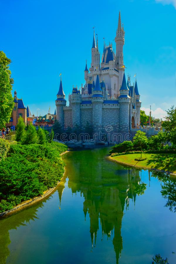 Cinderella`s castles reflecting in a lake in Magic Kingdom, Orlando, Florida stock images