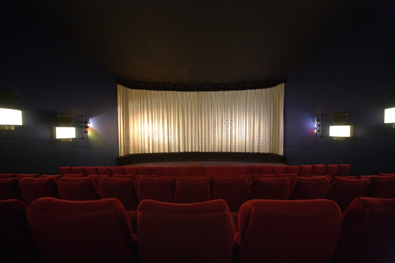 Cinema. Rows of chairs in a cinema with the curtain drawn stock photo
