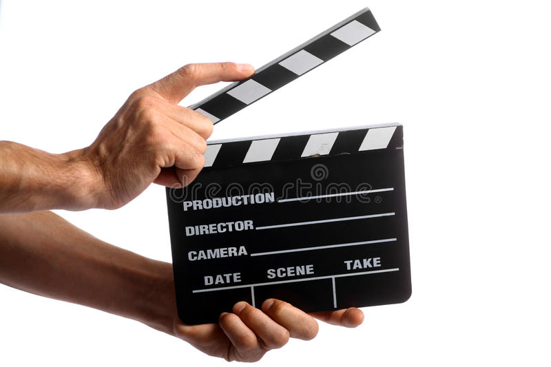 Cinema clap. Two hands holding a cinema clap isolated on white stock images