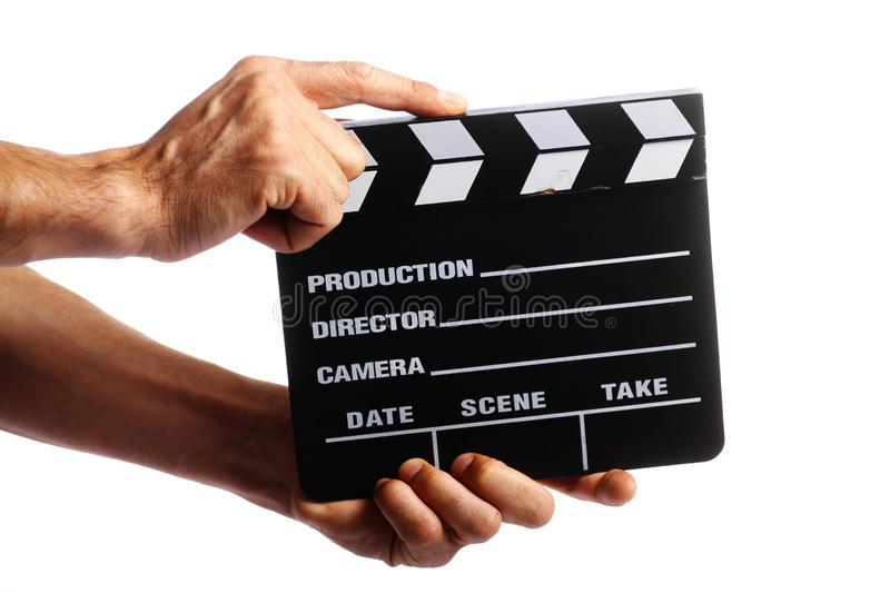 Cinema clap. Two hands holding a cinema clap isolated on white royalty free stock images