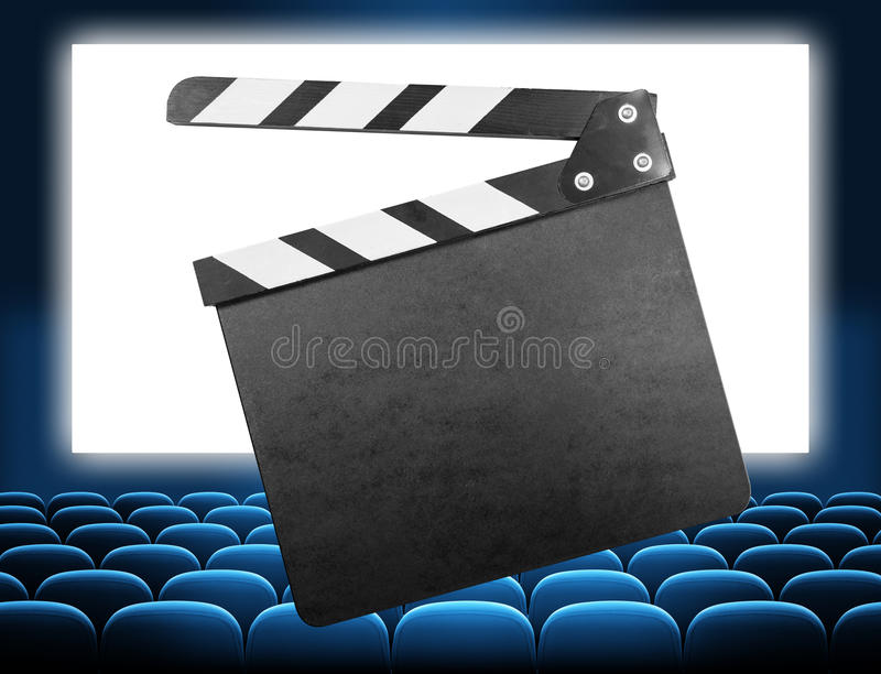 Cinema clapper board on movie screen blue audience royalty free stock photos