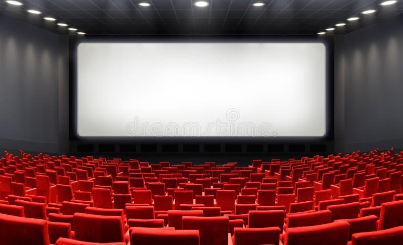 Cinema con lo schermo in bianco ed i sedili rossi fotografie stock libere da diritti