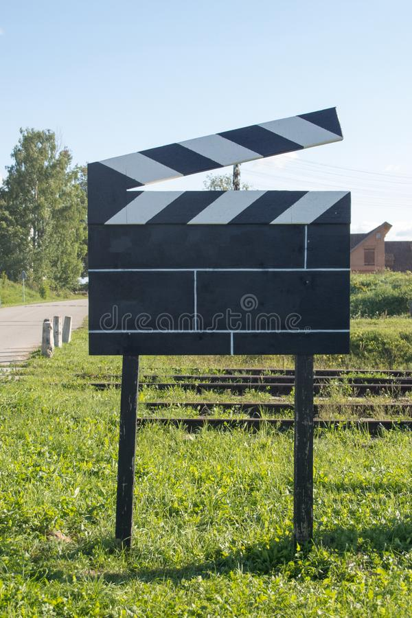 Cinema Concept Big Size Movie Clapper at Ourside on Green Grasses at Outside stock photography