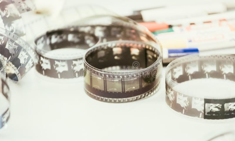 Cinema film reel or filmstrip, close up picture. Filmstrip or film reel on a cutting table, vintage film production in cinema, motion, picture, cinematography royalty free stock image