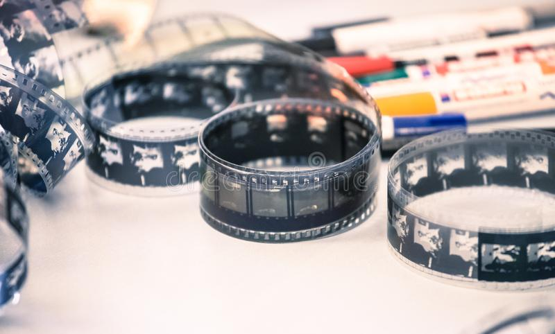 Cinema film reel or filmstrip, close up picture. Filmstrip or film reel on a cutting table, vintage film production in cinema, motion, picture, cinematography stock image