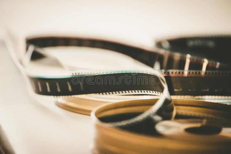 Cinema film reel or filmstrip, close up picture. Filmstrip or film reel on a cutting table, vintage film production in cinema, motion, picture, cinematography royalty free stock photos