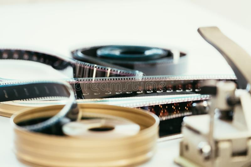 Cinema film reel or filmstrip on a cutting table. Filmstrip or film reel on a cutting table, vintage film production in cinema, motion, picture, cinematography stock photo