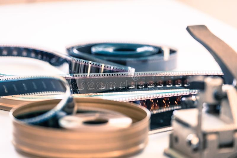 Cinema film reel or filmstrip on a cutting table. Filmstrip or film reel on a cutting table, vintage film production in cinema, motion, picture, cinematography royalty free stock photo