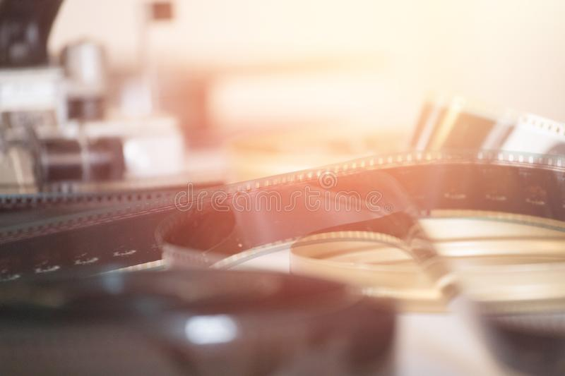 Cinema film reel or filmstrip on a cutting table. Filmstrip or film reel on a cutting table, vintage film production in cinema, motion, picture, cinematography stock images