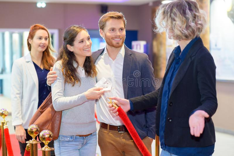 Cinema goers queuing for entree stock images