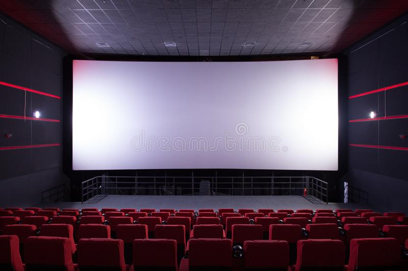 Cinema hall with red chairs stock photos