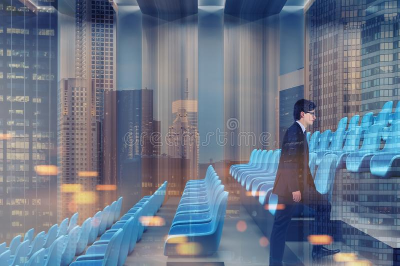 Cinema interior, blue chairs, businessman side. Businessman in a modern cinema interior with gray and dark wooden walls, a concrete floor, and blue chairs. A vector illustration
