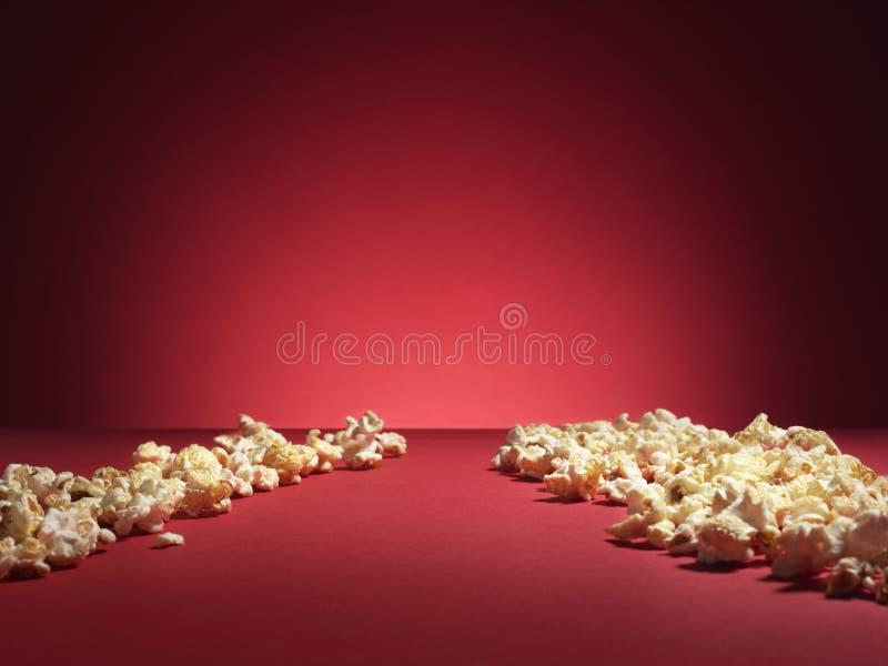 Cinema popcorn spotlight - Stock Image stock photography