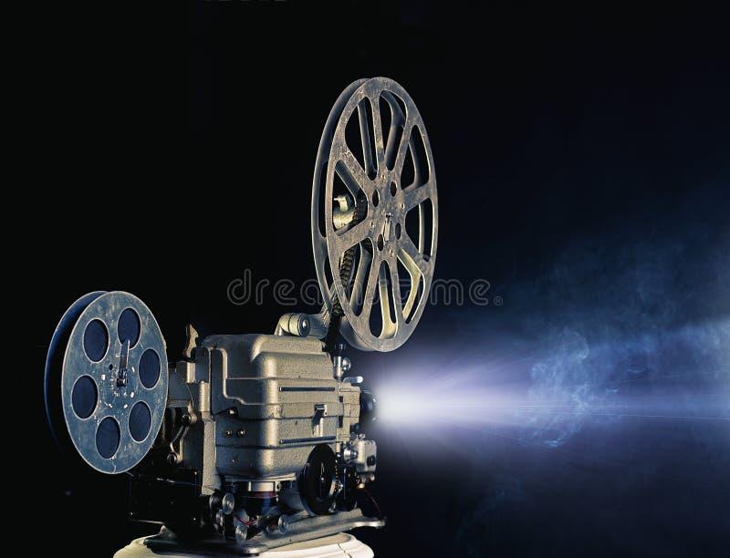 Cinema projector. Lighting old cinema projector photo