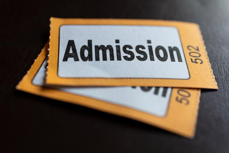 Cinema Theatre Event Admission Tickets. Macro close up of traditional style cinema, theatre or event admission or entrance tickets royalty free stock images