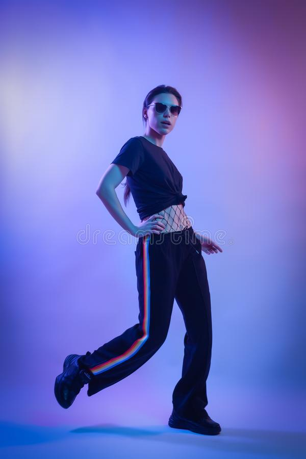 Warrior woman in Pink Blue neon ligh royalty free stock photography