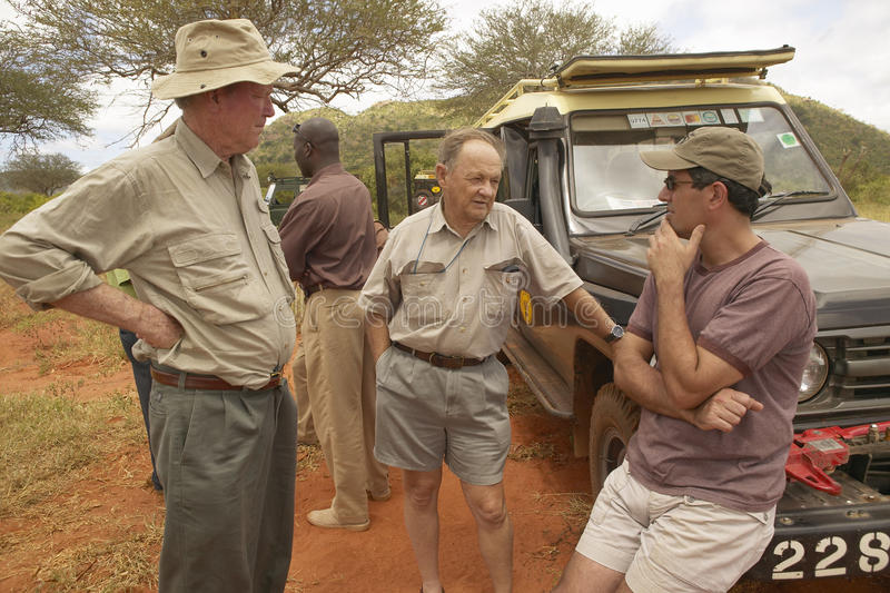 Cinematographer of Out of Africa speaks with John Taft and Humane Society CEO Wayne Pacelle in Tsavo National Park Kenya Africa stock photos