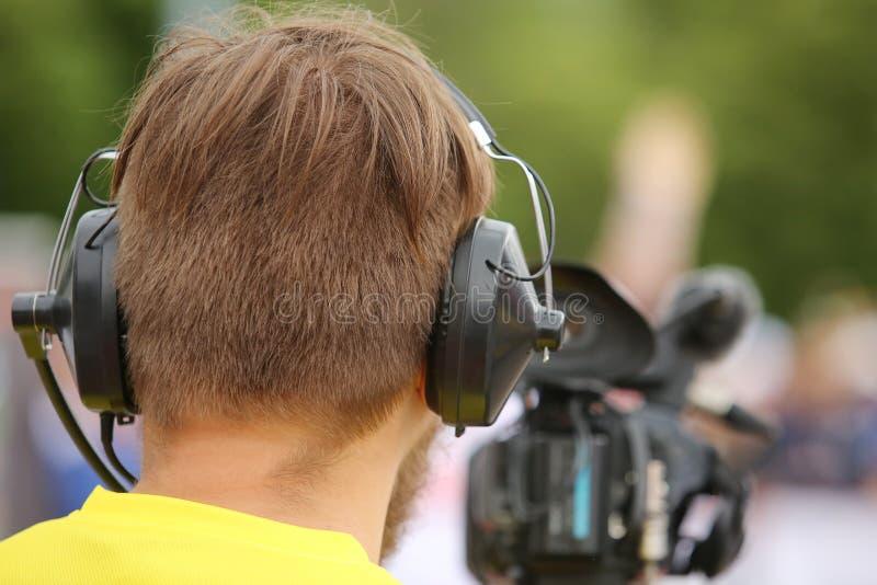 Cineoperatore sul lavoro fotografia stock