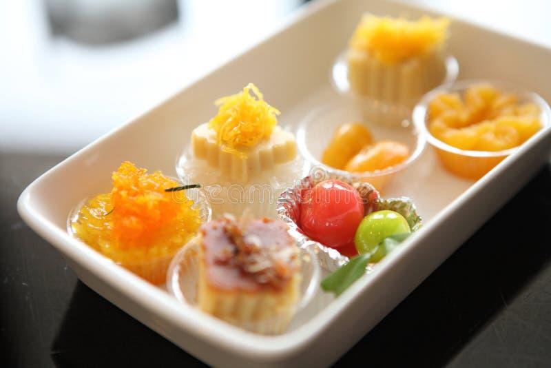 Cinghia tailandese Yod, fili dorati, semi falsi della giaca, dessert d'imitazione deletable del dessert di frutti fotografie stock