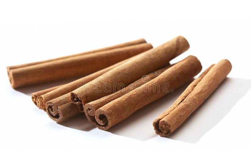 Cinnamon. Bark of cinnamon over white background royalty free stock photos