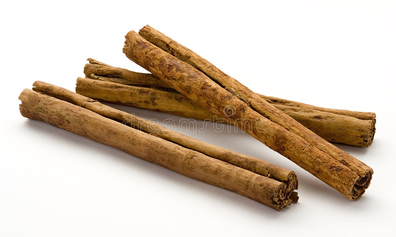 Cinnamon. Against a white background royalty free stock image