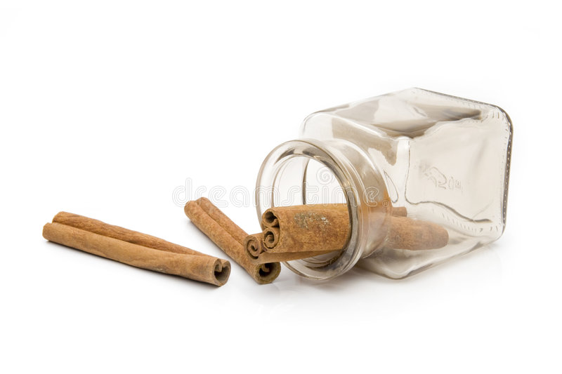 Cinnamon. In spice jar on white background stock photography