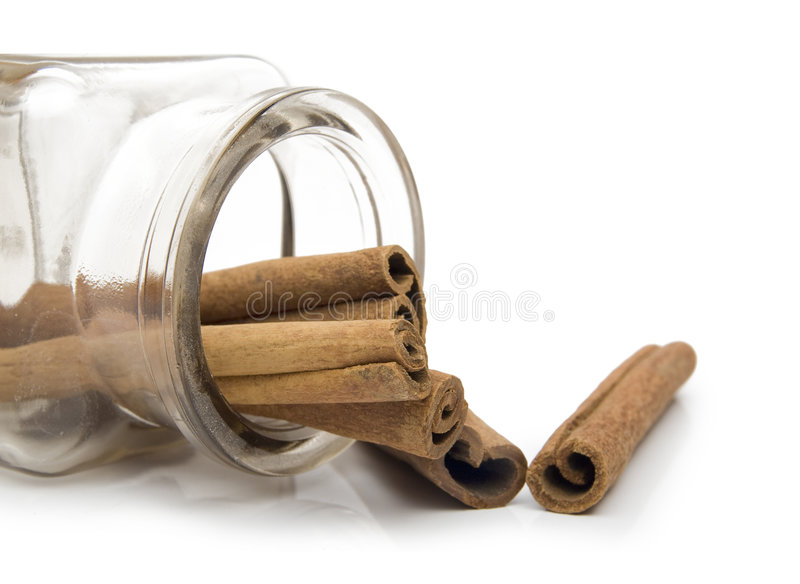 Cinnamon. In spice jar on white background royalty free stock image