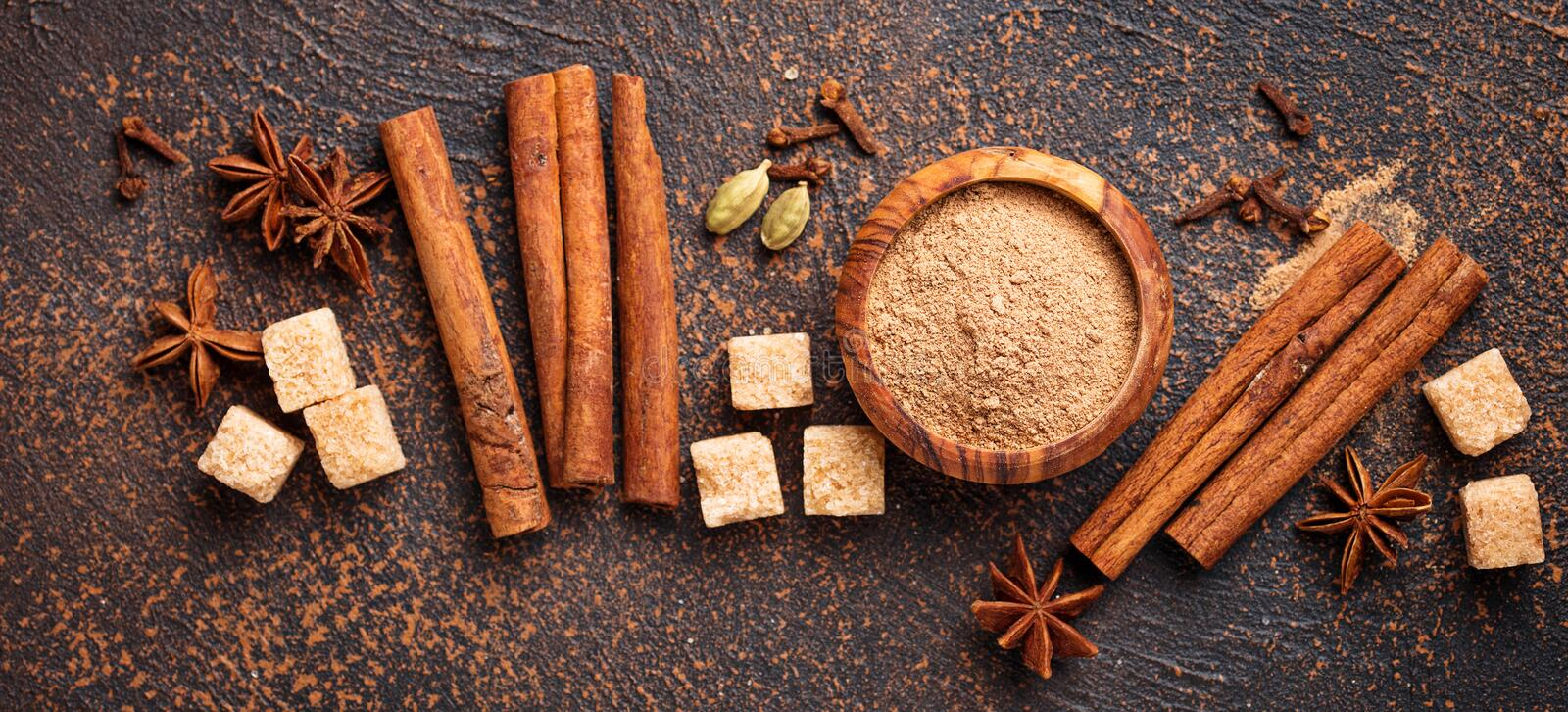 Cinnamon, anise, cardamom, clover and sugar. Winter spices cinnamon, anise, cardamom, clover and sugar. Top view, banner for design site stock photo