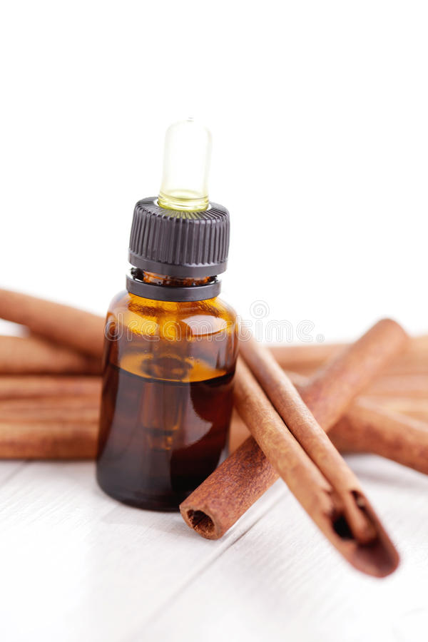 Cinnamon aromatherapy oil royalty free stock images
