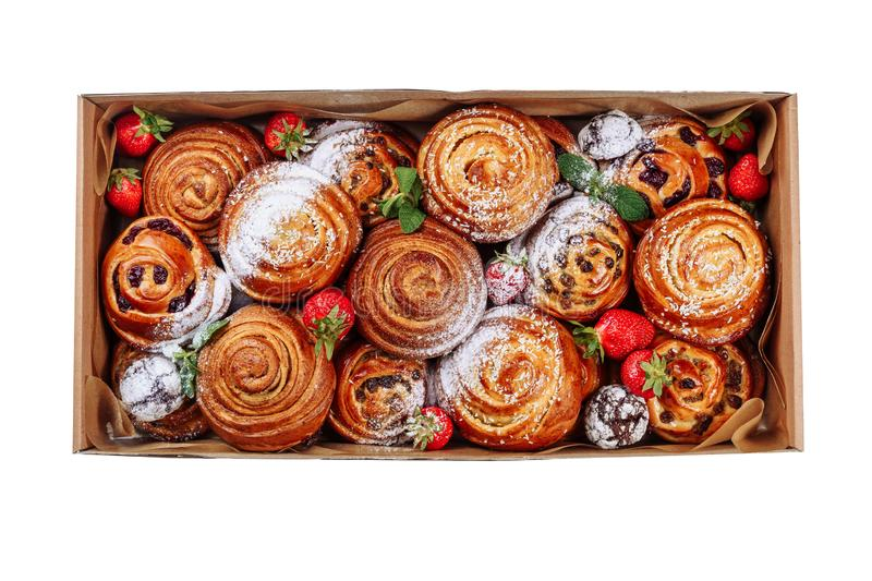 Cinnamon Bun Sweet Roll Pastry Carton Delivery Box. Top View Isolated on White Background. Danish Bakery Cake with Strawberry and Sugar Powder. Swirl Baked royalty free stock photography
