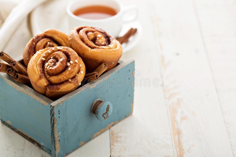 Cinnamon buns for breakfast. Made in a muffin tin stock photography
