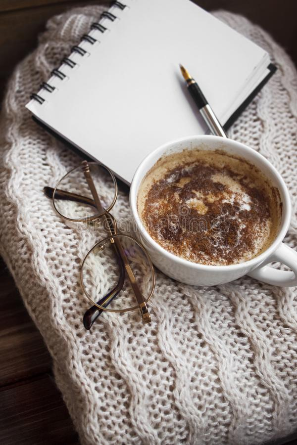 Cinnamon cappucino with cozy details stock images