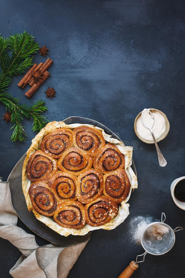 Cinnamon and cardamom buns  in an old baking tin. Top view, blank space stock photos