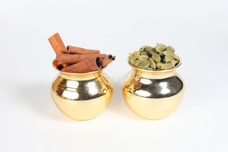 Cinnamon cardamom spice in shiny metal pot stock images