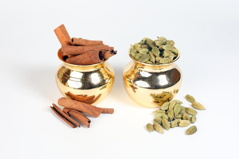 Cinnamon cardamom spice in shiny metal pot stock photography