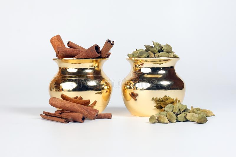 Cinnamon cardamom spice in shiny metal pot royalty free stock images