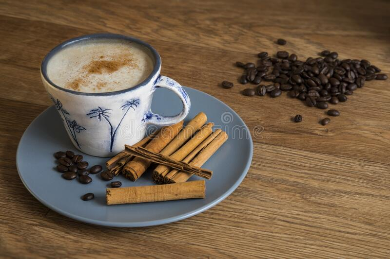Cinnamon coffee and coffee beans. royalty free stock images