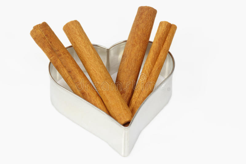 Cinnamon and cookie cutter royalty free stock images