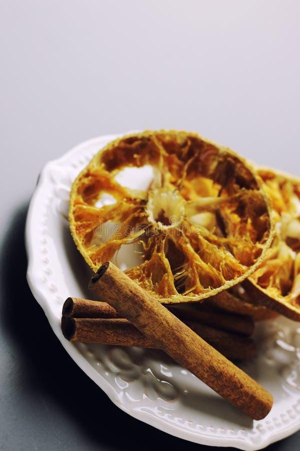 Cinnamon and dried orange slices stock photo