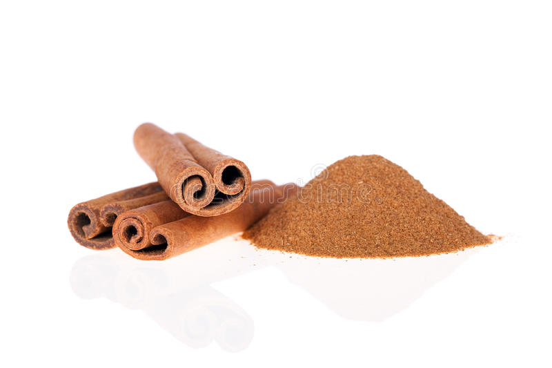 Cinnamon ground and sticks isolated stock images