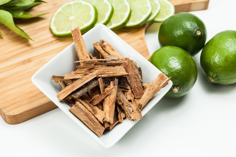 Cinnamon and lemon photo on neutral background.  stock photo