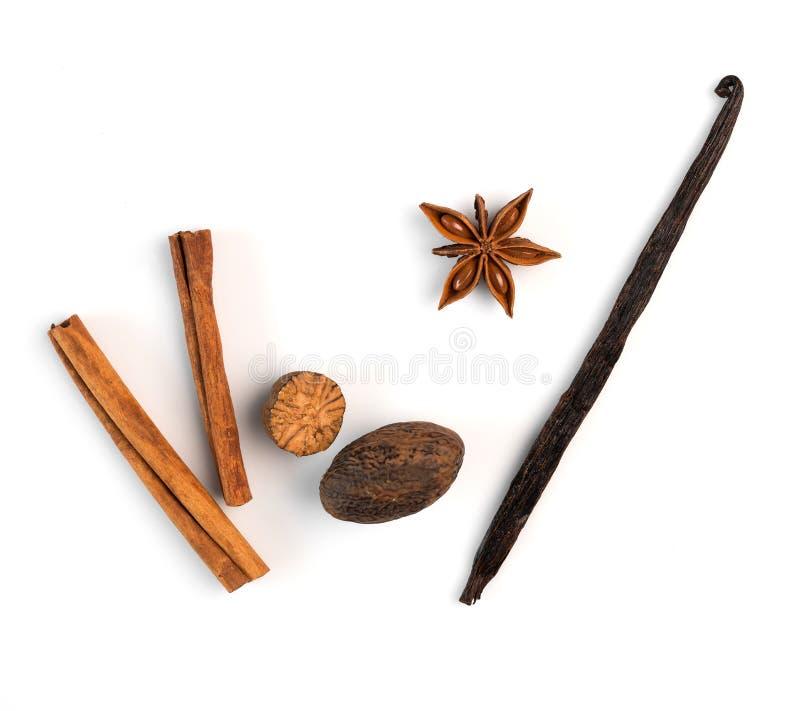 Cinnamon, nutmeg and vanilla on a white background. Isolated stock photos