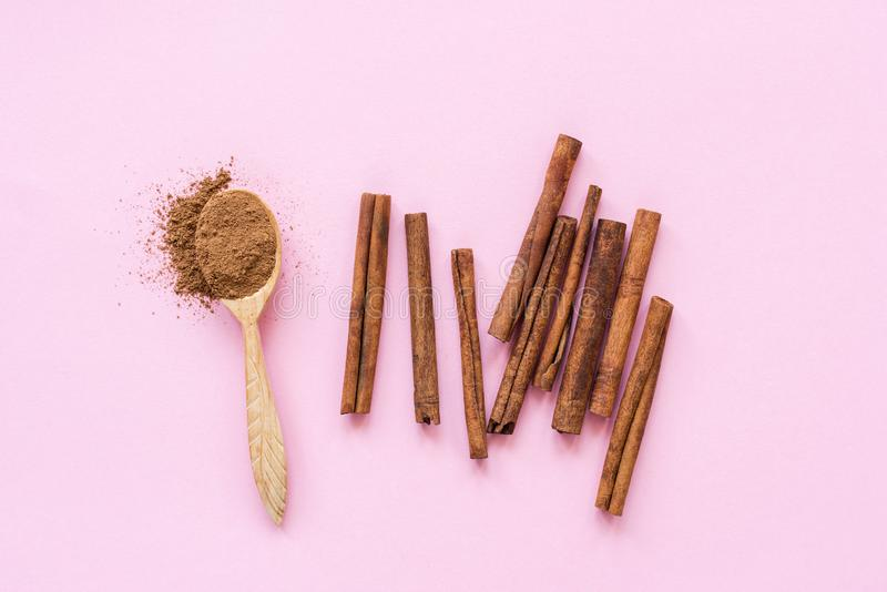Cinnamon on pink background stock photography