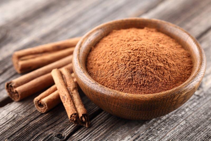 Cinnamon powder with sticks stock image