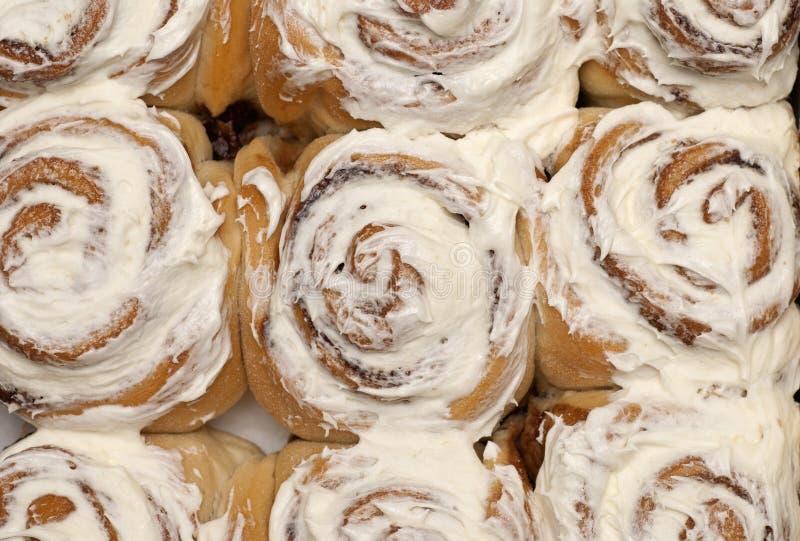 Cinnamon rolls background stock image