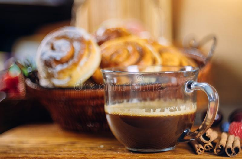Cinnamon rolls with coffee on wooden table. Soft focus, dessert, food, glass, sweet, breakfast, pastry, baked, bun, snack, sugar, homemade, bakery, fresh, bread stock photos
