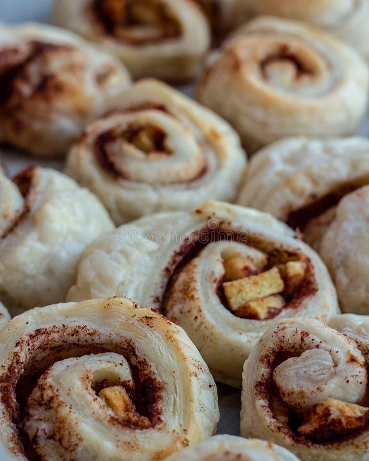 Cinnamon rolls. Fresh sweet homemade cinnamon rolls with apple stock photos
