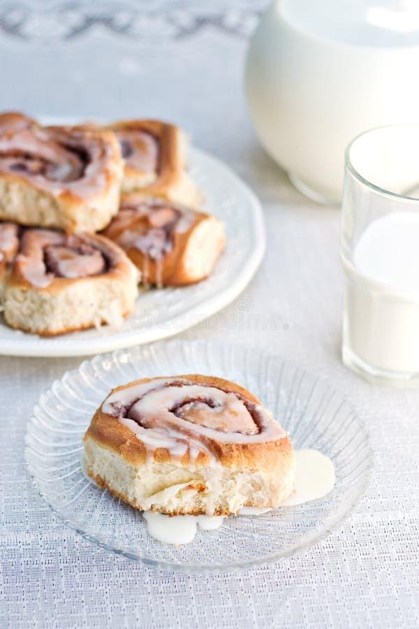Cinnamon rolls and milk stock image
