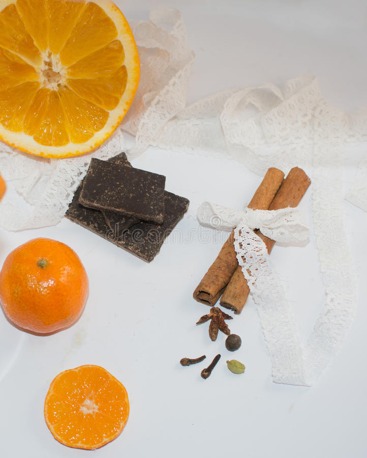 Cinnamon, spice, mandarin and orange on a white background stock photos